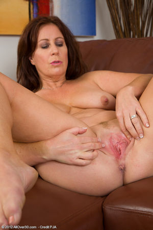 Hot mature brunette Carol Foxwell..