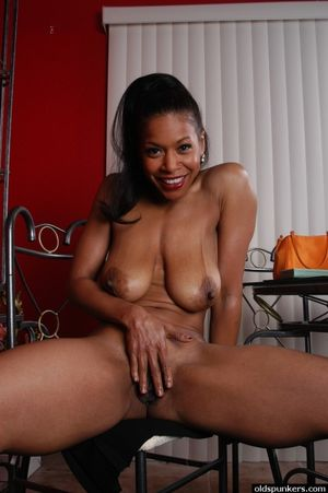 Mature ebony model spreads older black..
