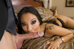 Desirable Asa Akira sucks a big cock..