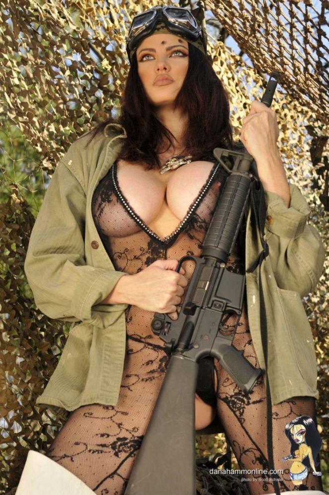 Erotic girl military cap lingerie stick stock photo