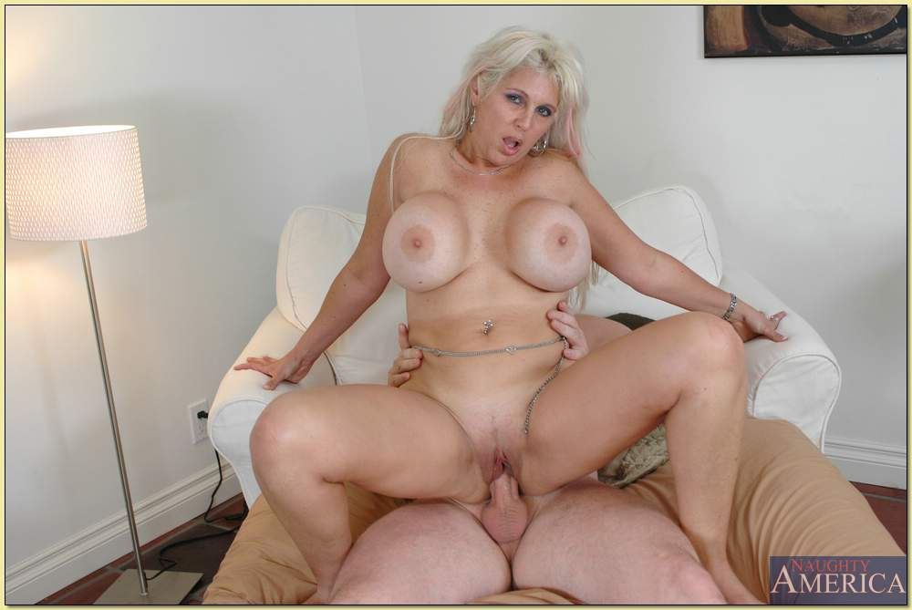 Busty step mom tugs hard young cock on photo