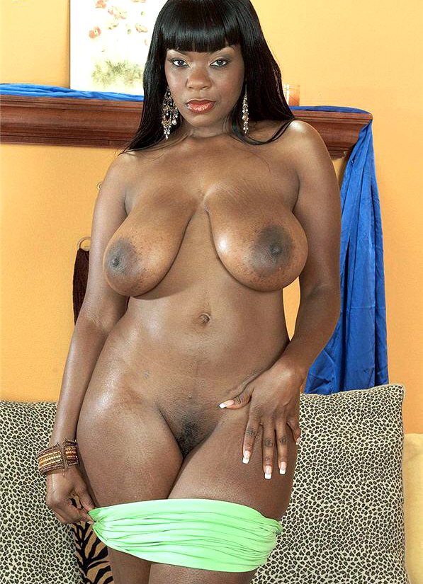 Voluptuous black babe with big boobs teasing