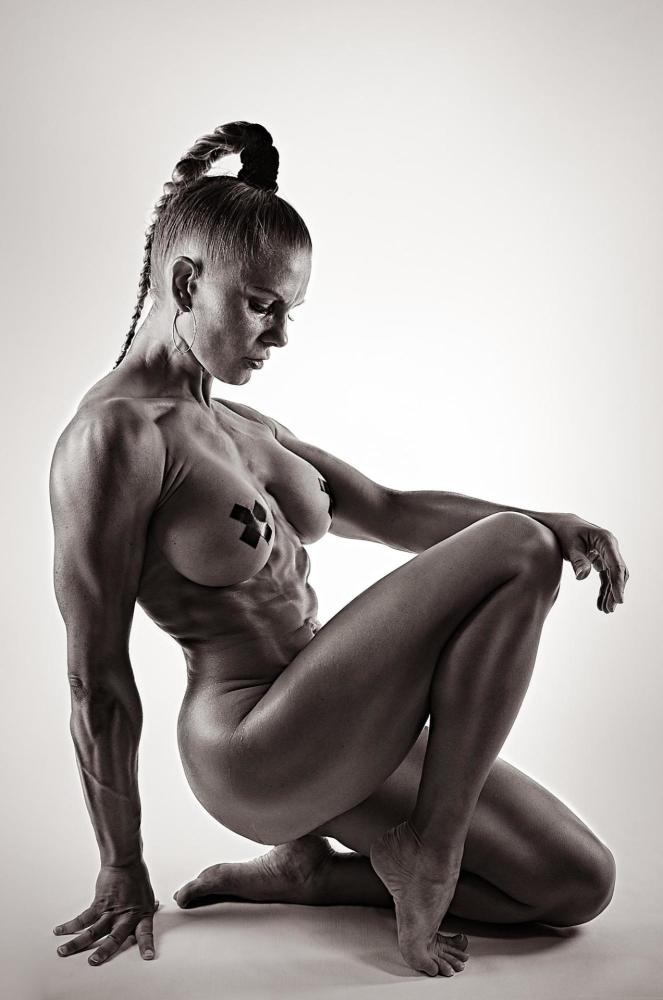 Fit and sexy young female bodybuilder stock photo