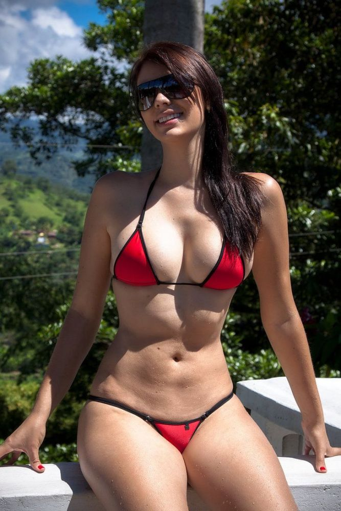 A sexy young milf strips out of her black bikini
