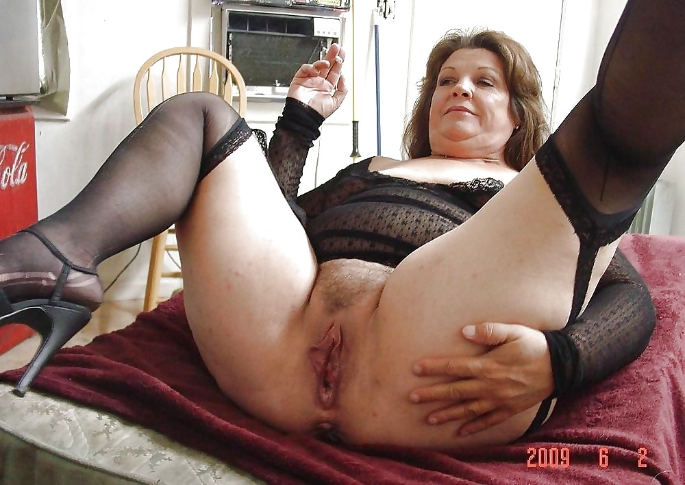 Old woman with huge boobs plays with her pussy in nylons and garters