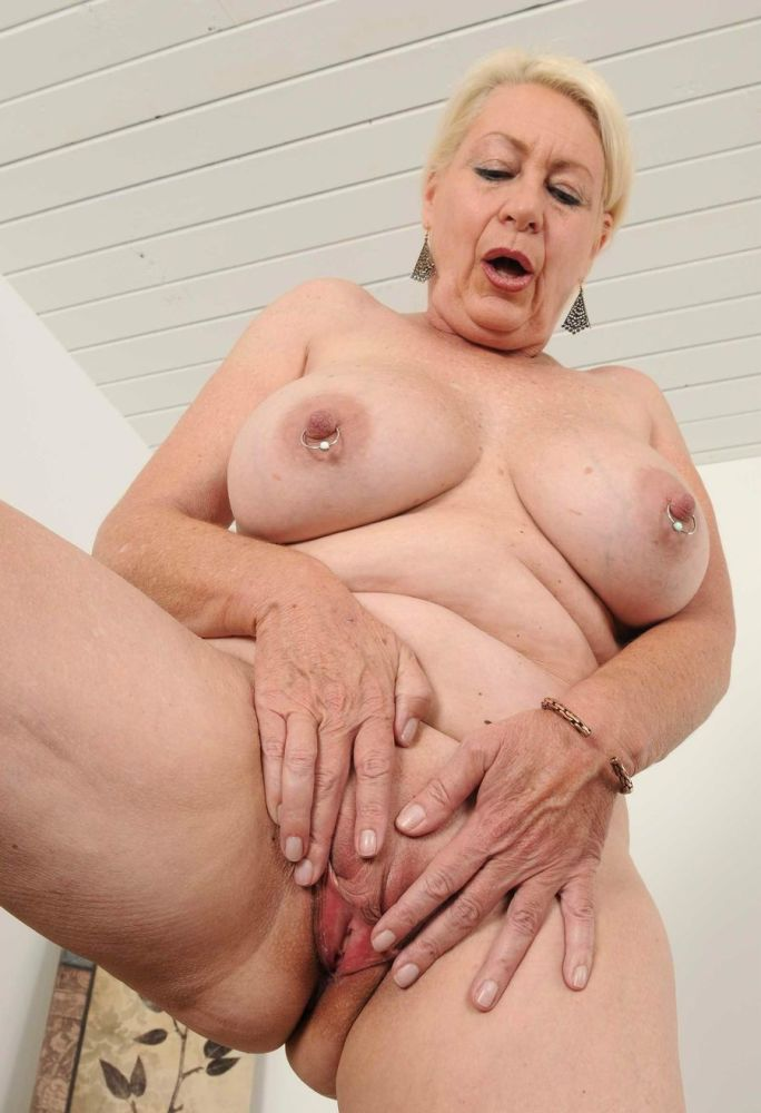 Glassed plump granny exposes big boobs and hairy pussy